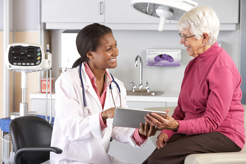 doctor discussing records senior patient