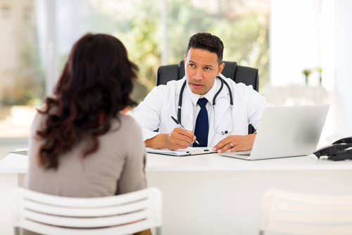male doctor consulting patient
