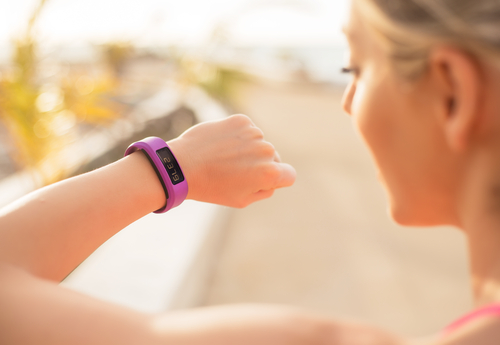 woman checking fitness wearable
